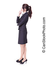 business woman think something in profile - Full length of...
