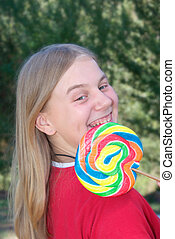 girl with lollipop - a girl with a brig swirly lollipop