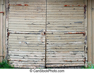Yellow garage door - Garage door with peeling yellow paint...