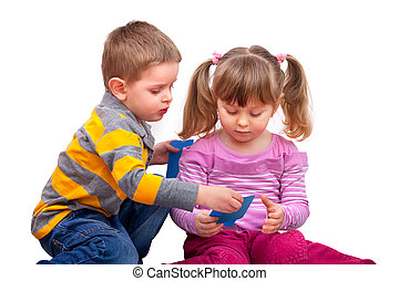 cute boy and girl are playing with a cards, isolated on...