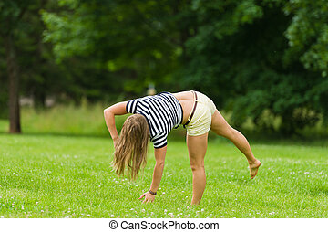Cartwheel - Young girl start doing cartwheel at the park...