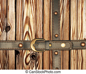 Old wooden boards and leather belt - Grunge background Old...