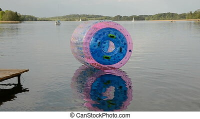 empty zorbing ball on lake water - empty zorbing ball on...