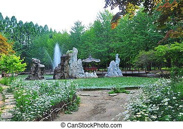 Garden at Nami Island - A bridge going through the park at...