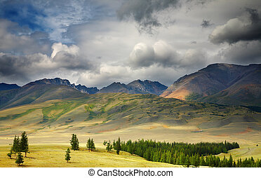 Mountain view - Mountain landscape with storm clouds