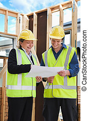 at the construction site - civil engineer and worker...