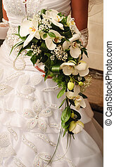 Bride's bouquet - Bride hold the bouquet from white orchids