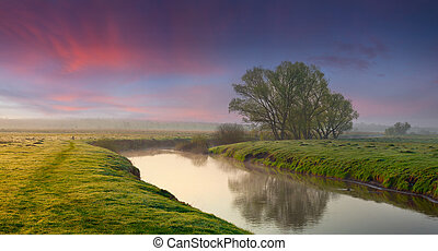 Panorama of summer sunrise on the river.