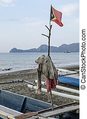east timor flag in fishing boat dili timor leste coast