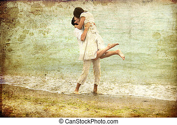 Couple kissing at the beach. Photo in old colour image...