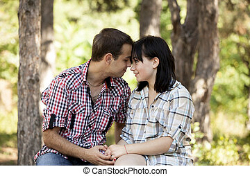 Young teenage couple in park.