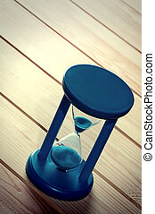 Hourglass on wooden surface - Hourglass on wooden boards