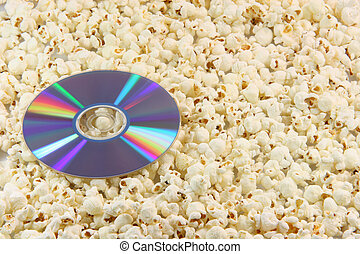 dvd disc on popcorn - dvd disc movie on pop corn background...