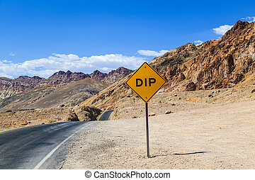 scenic road Artists Drive in Death valley with colorful...