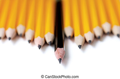 Leading - Low angle shot of Uneven row of yellow pencils...