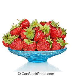 Strawberries in blue glass plate isolated on white...