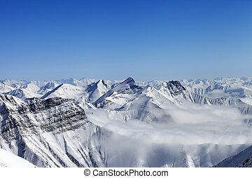 Snowy mountains in haze. Caucasus Mountains, Georgia.