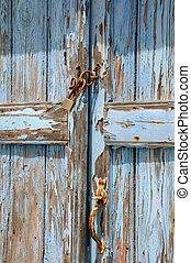 Old Shabby Unpainted Door - Detail of old blue shabby door...