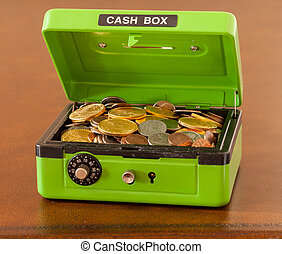 Green cash box with gold and silver coins - Green cash box...