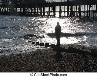 Figure on beach in Hastings