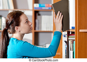 girl in library - young girl in library