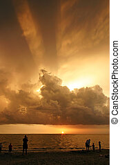 Group watching amazing tropical sunset - Group of people...