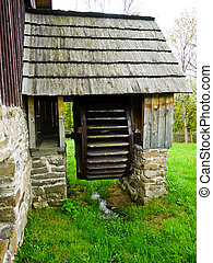 Wooden mill wheel - Old rustic and wooden water wheel on...