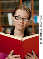 girl in library with book