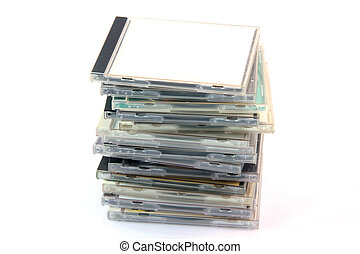 pile of cd cases isolated on white background and empty...
