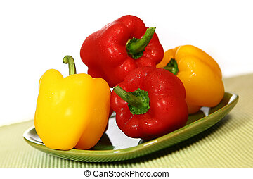 Bright Colorful Bell Peppers  on Green and White Background