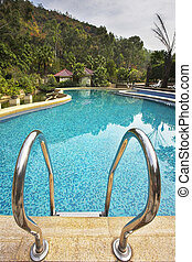 Pool with pure transparent water and hand-rail