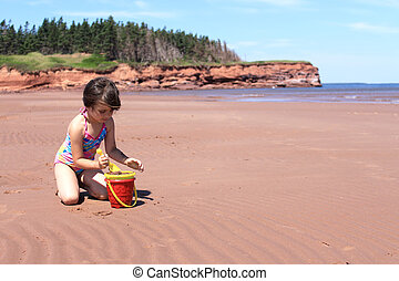 Little girl at the beach in P.E.I - Llittle girl playing in...