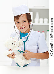 Little boy playing veterinary doctor