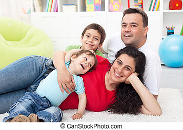 Happy young family with two kids