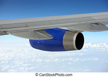 Wing of the plane on a background of sky