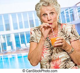 Portrait Of A Elderly Woman Drinking Juice