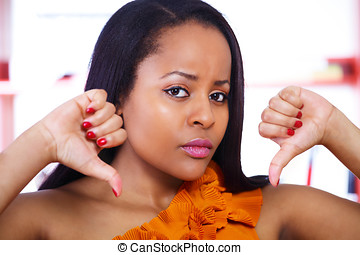 Thumbs down girl - Young woman making thumbs down handsign