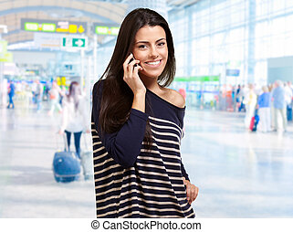 Portrait Of A Woman Talking At Airport, Outdoor