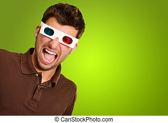 Astonished Man Wearing 3d Glasses Isolated On Green...