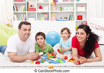 Kids with their parents playing
