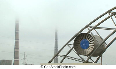 Chimneys and turbine - Industrial view that includes...