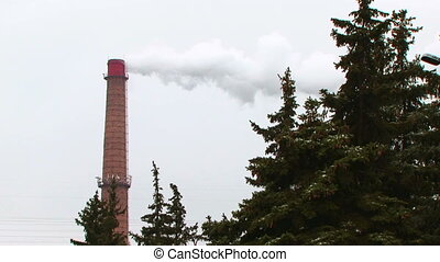 Chimney polluting environment - Chimney steaming near the...