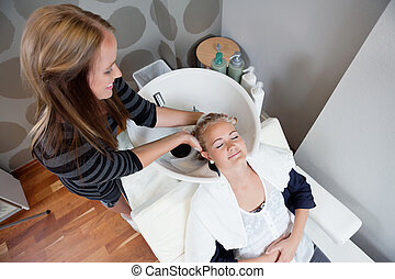 Woman Getting a Hair Wash Before Haircut - High angle view...