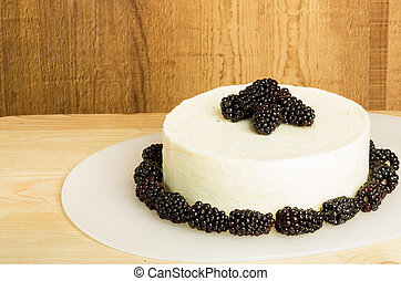 White cheddar cheese with blackberries
