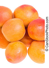 Ripe apricots isolated on white