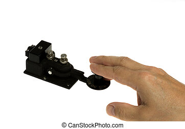 Telegraph key and hand isolated on white - A telegraph key...