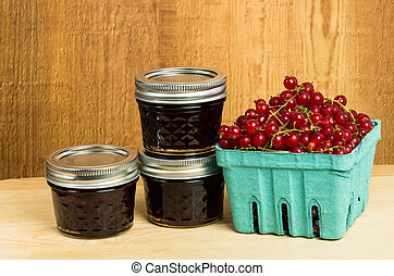 Red currant jelly and currants on wooden table - Fresh red...