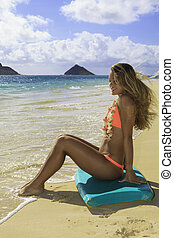 girl on the beach in bikini with boogie board - beautiful...