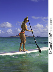 girl in bikini on her stand up paddle board - beautiful girl...