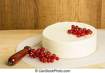 White cheddar cheese block with currants